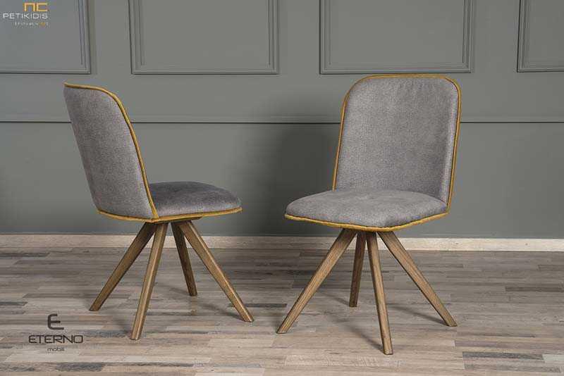Καρέκλα Libre με πόδια από δρυς μασίφ ξύλο με ιδιαίτερη καμπύλη στην πλάτη. Το ύφασμα είναι αλέκιαστο και αδιάβροχο σε χρώμα γκρι και ρέλι κίτρινο για να αντενδείκνυται ακόμα περισσότερο το σχήμα της.