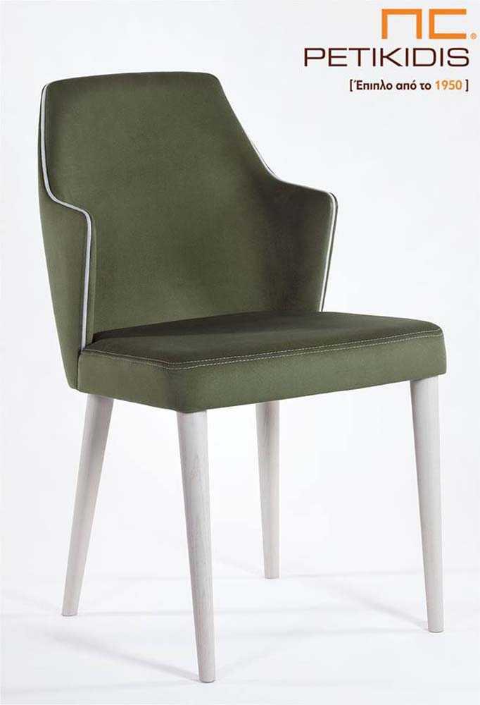 Καρέκλα Lilla με ξύλινα πόδια και ύφασμα αδιάβροχο στο κάθισμα και την πλάτη. Διαθέτει ιδιαίτερες λεπτομέρειας στην ραφή και διχρωμία στο ρέλι σε πράσινους τόνους.