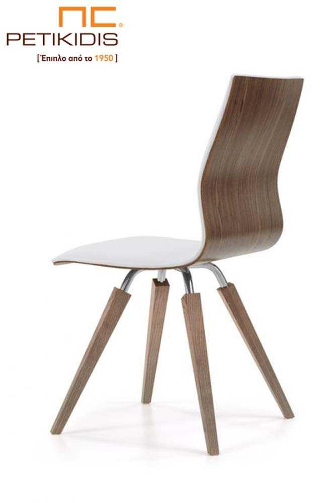 Καρέκλα Νο31 με πόδια σε συνδυασμό μέταλλου inox και ξύλου.Η πλάτη και το κάθισμα είναι ενιαία. Η εσωτερική πλευρά του καθίσματος είναι με ύφασμα σε λευκό χρώμα αλέκιαστο και αδιάβροχο ενώ η εξωτερική είναι με εμφανή ξύλο.