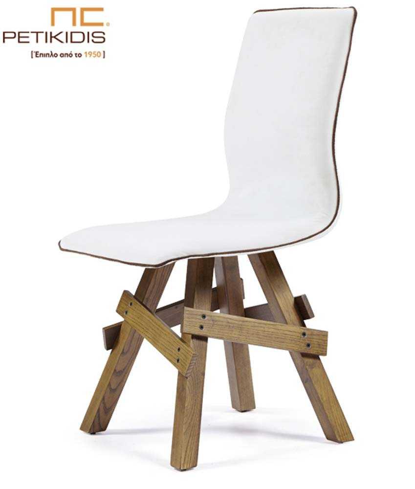 Καρέκλα Νο36 με πόδια σε ρουστίκ σχεδιασμό από μασίφ ξύλο δρυς. Η πλάτη είναι ενιαία με το κάθισμα και επενδεδυμένα με τεχνόδερμα λευκό και λεπτομέρεια σε σκούρο χρώμα κορδόνι στην άκρη.