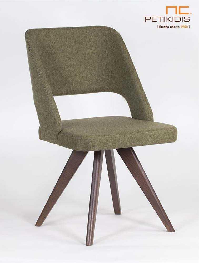 Καρέκλα Pollita με μασίφ ξύλινα πόδια. Η πλάτη και το κάθισμα είναι με ύφασμα για μεγαλύτερη άνεση σε πράσινους τόνους αλέκιαστο και αδιάβροχο.