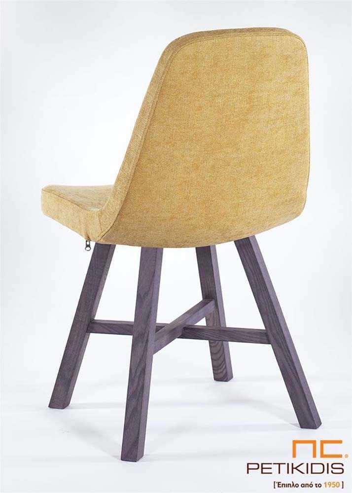Καρέκλα Turea με μασίφ ξύλινα πόδια και κάθισμαμε ύφασμα αδιάβροχο σε έντονο κίτρινο χρώμα. Λεπτομέρεια.