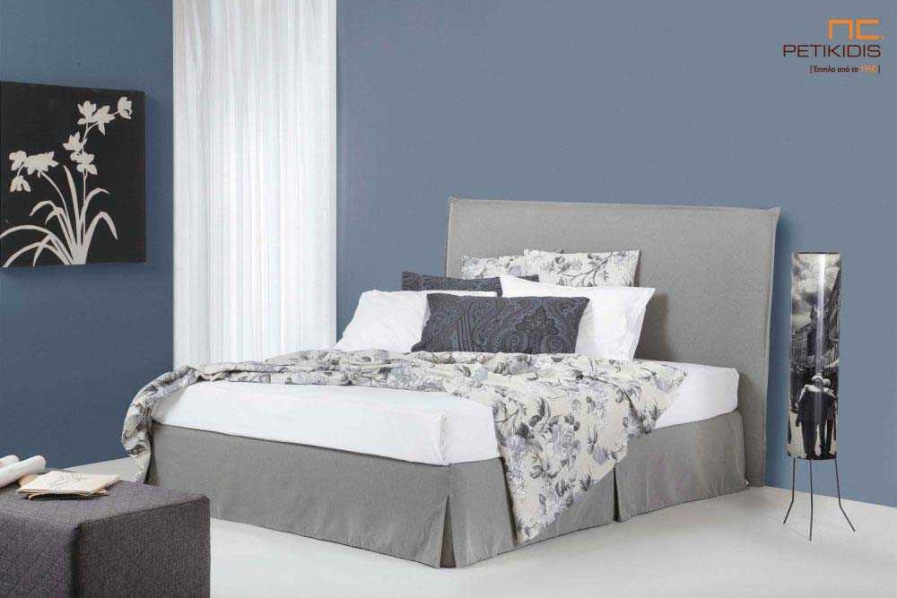 Υφασμάτινο κρεβάτι Anais της Linea Strom σε γκρι ύφασμα μονόχρωμο αλέκιαστο και αδιάβροχο. Το ύφασμα αφαιρείται από την βάση και το κεφαλάρι για εύκολο καθάρισμα.