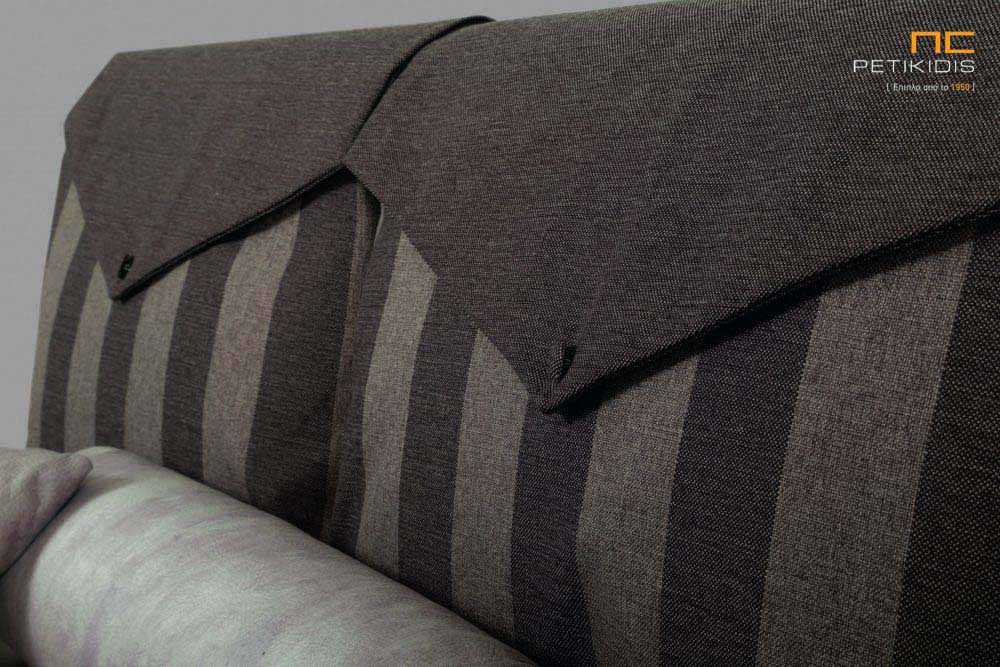 Υφασμάτινο κρεβάτι Betina της Linea Strom σε καφέ ύφασμα μονόχρωμο και ρίγα στις μαξιλάρες του κεφαλαριού. Το ύφασμα είναι αποσπώμενο και από τη βάση και από το κεφαλάρι για εύκολο καθάρισμα. Λεπτομέρεια μαξιλάρας.