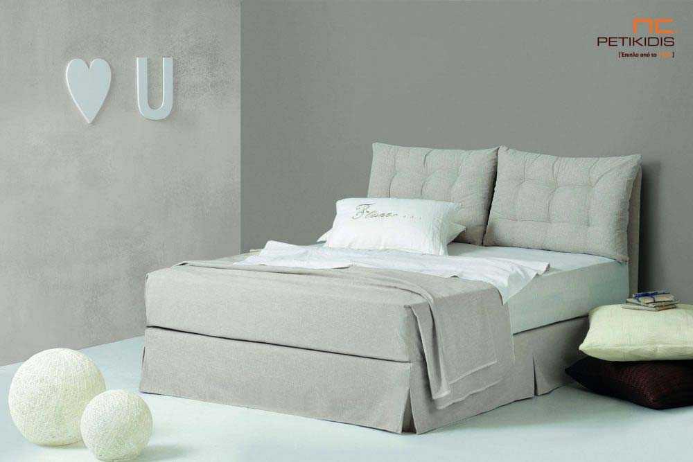 Υφασμάτινο κρεβάτι Cocoon της Linea Strom σε ανοιχτό γκρι μονόχρωμο ύφασμα.Το ύφασμα είναι αποσπώμενο και από την βάση και από το κεφαλάρι .