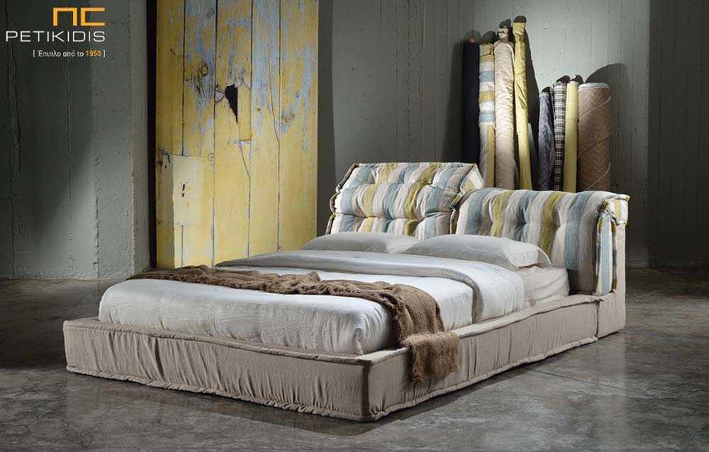 Υφασμάτινο κρεβάτι Diva με αποσπώμενο ύφασμα και από την βάση και από το κεφαλάρι. Στο κεφαλάρι διαθέτει μηχανισμό ανάκλησης για μεγαλύτερη άνεση.
