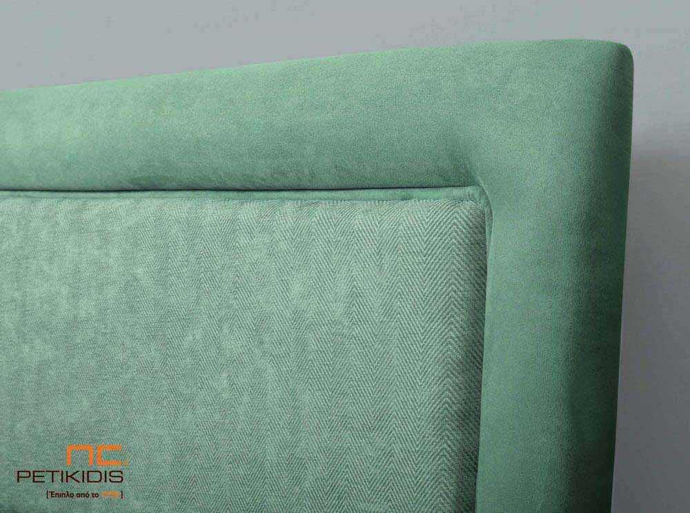 Υφασμάτινο κρεβάτι Ermina της Linea Strom σε ανοιχτό πράσινο μονόχρωμο ύφασμα. Λεπτομέρεια κεφαλαριού.