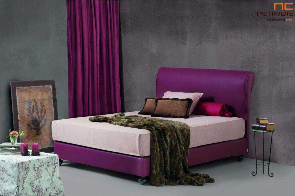 Υφασμάτινο κρεβάτι Iro της Linea Strom σε μοβ ύφασμα μονόχρωμο αλέκιαστο και αδιάβροχο.Το ύφασμα αφαιρείται από βάση και κεφαλάρι για εύκολο καθάρισμα.