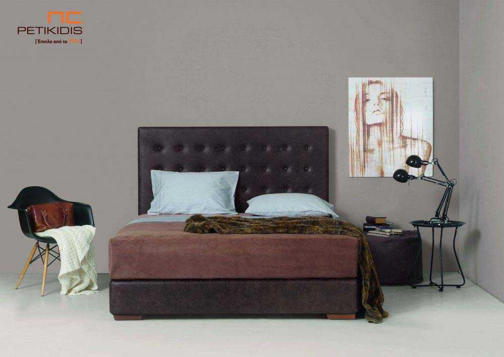 Υφασμάτινο κρεβάτι Milva της Linea Strom σε καφέ ύφασμα μονόχρωμο αλέκιαστο και αδιάβροχο με καπιτονε κεφαλάρι. Το ύφασμα αφαιρείται από την βάση και το κεφαλάρι για εύκολο καθάρισμα.