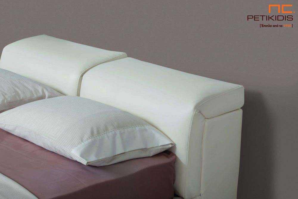 Υφασμάτινο κρεβάτι Nuovo της Linea Strom σε εκρου ύφασμα μονόχρωμο αλέκιαστο και αδιάβροχο. Στο κεφαλάρι διαθέτει μηχανισμούς ανάκλησης για μεγαλύτερη άνεση. Λεπτομέρεια κεφαλαριού.