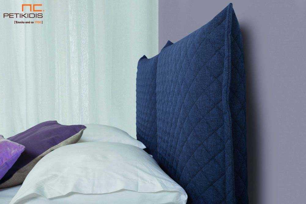 Υφασμάτινο κρεβάτι Prima της Linea Strom σε ύφασμα μονόχρωμο αλέκιαστο και αδιάβροχο καπιτονέ μπλε. Το ύφασμα αφαιρείται από την βάση και το κεφαλάρι για εύκολο καθάρισμα . Λεπτομέρεια κεφαλαριού.