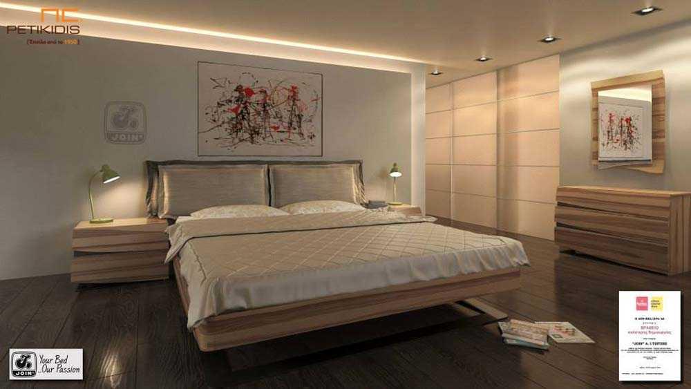 Κρεβατοκάμαρα Άλκηστις Pillow της join με αποσπώμενα μαξιλάρια στο κεφαλάρι. Είναι από ξύλο ελιάς και στη βάση διαθέτει ιδιαίτερο μεταλλικό πόδι.