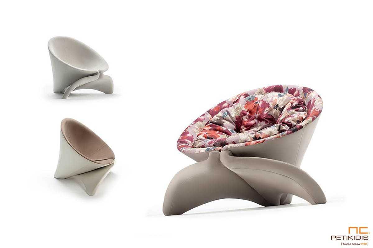 Πολυθρόνα Cone σε ιδιαίτερο σχεδιασμό με μεγάλη αίσθηση ανάπαυσης.Ύφασμα εξωτερικά αλέκιαστο και αδιάβροχο μονόχρωμο και εσωτερικά ύφασμα με λουλούδια σε καφέ κόκκινο συνδυασμό.