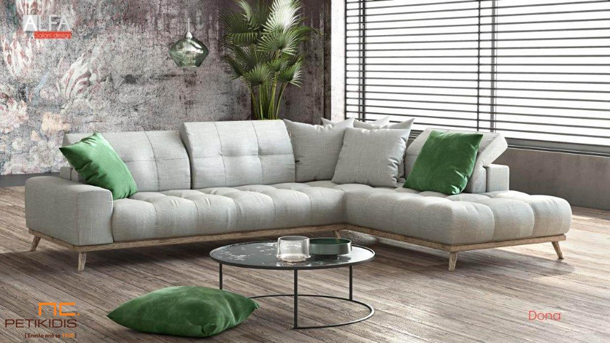 Σαλόνι γωνία Dona με ξύλινη βάση και καπιτονέ μαξιλάρια στην πλάτη και στο κάθισμα.Διαθέτει μηχανισμούς στα μαξιλάρια της πλάτης για μεγαλύτερη ανάπαυση με ύφασμα εκρου βελούδο αδιάβροχο και αλέκιαστο και διακοσμητικά μαξιλάρια σε πράσινο χρώμα.