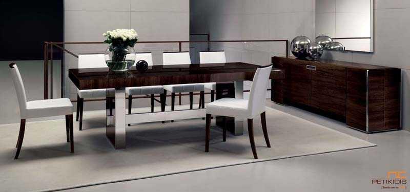 Τραπεζαρία One and only. Ο μπουφές διαθέτει τέσσερα ντουλάπια. Το τραπέζι έχει δύο προεκτάσεις και τα κεντρικά πόδια του έχουν λεπτομέρειες inox. Το λούστρο είναι γυαλιστερό και επιτρέπει να φαίνονται τα νερά του ξύλου. Οι καρέκλες έχουν λεπτομέρειες ξύλου με ίδιο φινίρισμα με το τραπέζι.