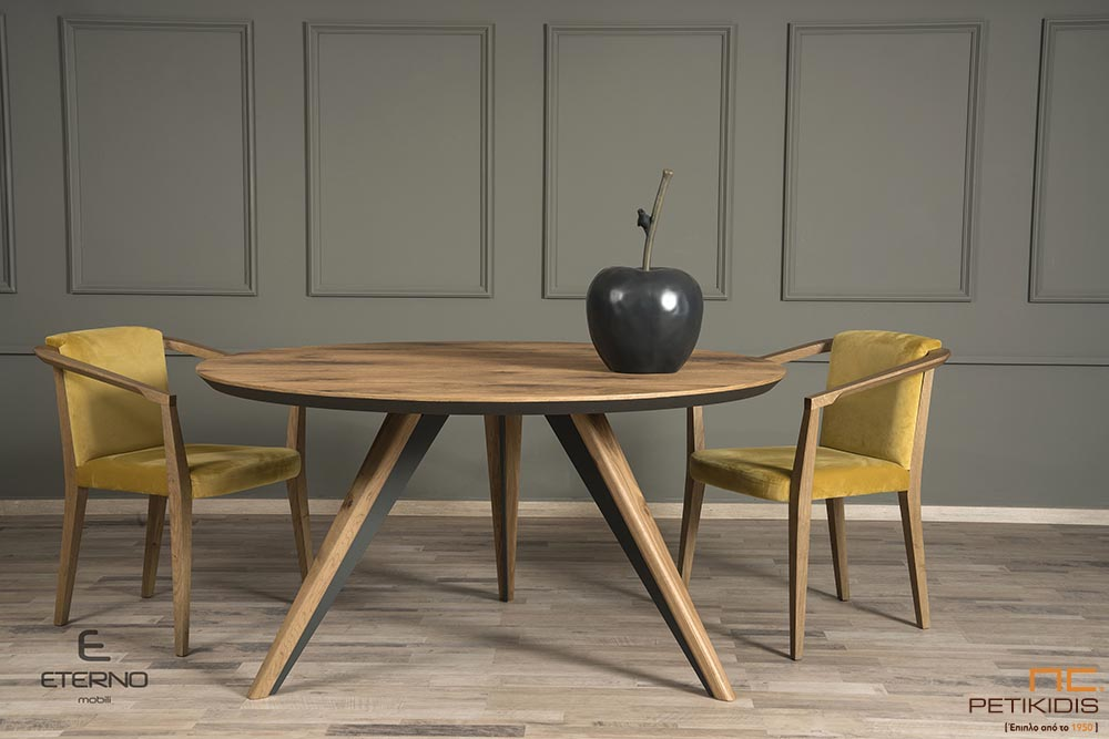 Τραπεζαρία ροτόντα Free από ξύλο δρυς ρουστίκ και λεπτομέρειες λάκας. Καρέκλες Life με αδιάβροχο βελούδινο ύφασμα και ξύλο δρυς.