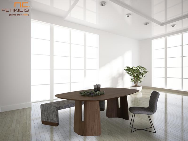 Τραπέζι Escape με καπάκι οβάλ και κεντρικά πόδια σε ξύλο καρυδιάς ακανόνιστη.Καρέκλα Grain με μεταλλική βάση και ύφασμα αλέκιαστο και αδιάβροχο. Πάγκος Grain με ύφασμα και λεπτομέρεια καρυδιάς.